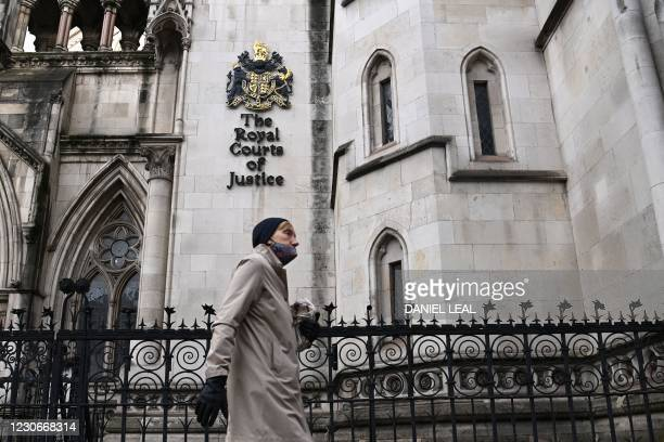 Pedestrian walks past the Royal Courts of Justice, home to the High Court, in London on January 19, 2021. - Meghan Markle's high-profile lawsuit...
