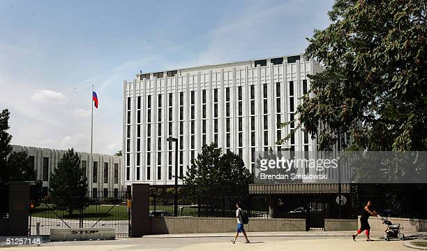 A pedestrian walks past the Russian Embassy September 2 2004 in Washington DC Russian has fallen victim to a series of terrorist attacks the latest...