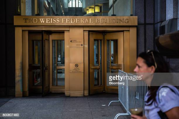 A pedestrian walks past the Ted Weiss Federal Building which houses offices of the Internal Revenue Service in New York US on Saturday June 24 2017...