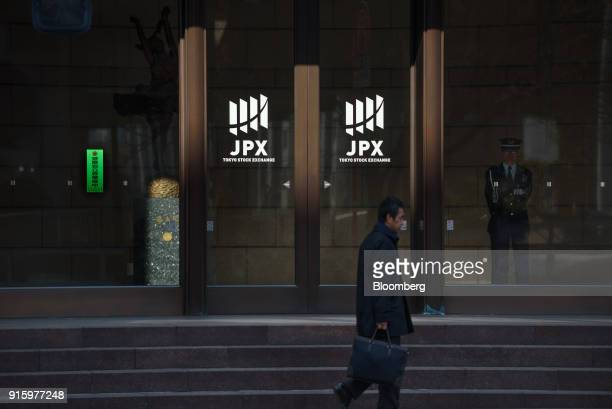Pedestrian walks past the Tokyo Stock Exchange building, operated by Japan Exchange Group Inc. , in Tokyo, Japan, on Friday, Feb. 9, 2018. The Topix...