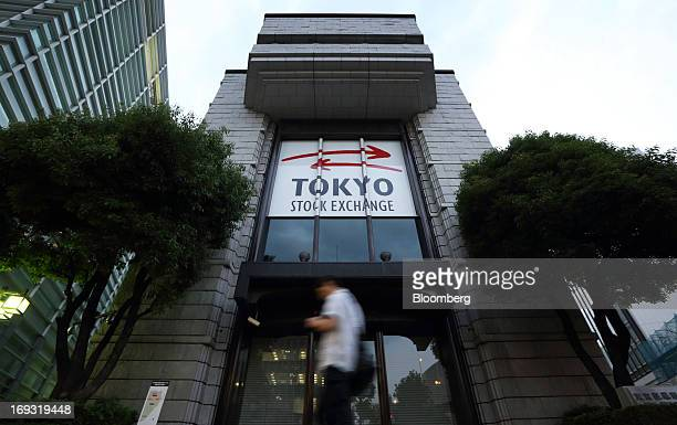 A pedestrian walks past the Tokyo Stock Exchange in Tokyo Japan on Thursday May 23 2013 Japan's Topix index slid more than 5 percent the most since...