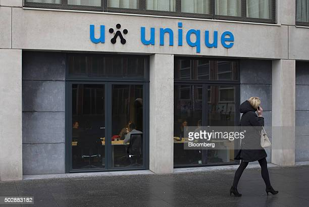A pedestrian walks past the Unique job center flagship store operated by USG People NV in Amsterdam Netherlands on Tuesday Dec 29 2015 Recruit...