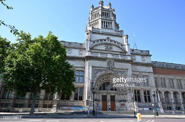 Pedestrian walks past the Victoria and Albert museum, currently closed to visitors due to the ongoing COVID-19 pandemic, in west London on June 23,...