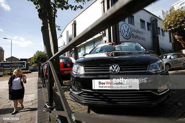 A pedestrian walks past Volkswagen AG dealership in London UK on Wednesday Sept 23 2015 Volkswagen AG's escalating scandal over emissionstest...
