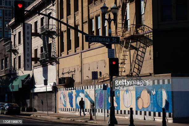 Pedestrian walks through downtown Stockton, California on February 7, 2020. - The city went bankrupt in 2012 but has been recovering and recently...