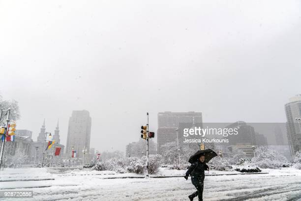 A pedestrian walks through snow and slush on March 7 2018 in Philadelphia Pennsylvania This is the second nor'easter to hit the Northeast within a...