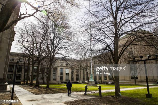 A pedestrian walks through the Massachusetts Institute of Technology campus in Cambridge Massachusetts US on Monday April 20 2020 Collegefinancial...