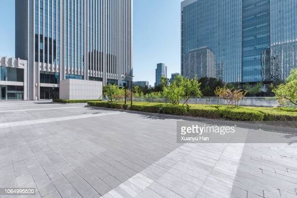 pedestrian walkway toward modern skyscrapers - business community stock pictures, royalty-free photos & images