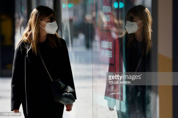 Pedestrian wearing a face covering walks past the House of Fraser department store, closed down due to Covid-19 restrictions, in central London on...