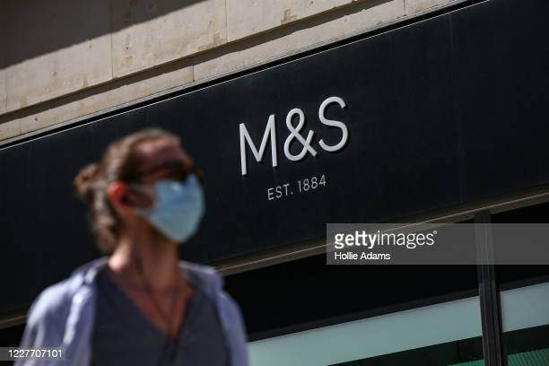A pedestrian wearing a face mask walks past the Marks Spencer store on Oxford Street on July 20 2020 in London United Kingdom Marks Spencer are...