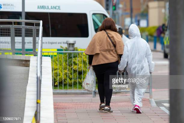 A pedestrian wearing a fullbody disposable hazardous materials paper suit walks near King's College Hospital operated by the King's College Hospital...