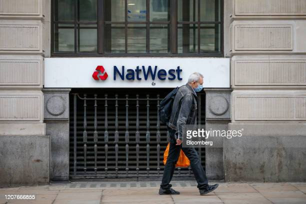Pedestrian, wearing a protective face mask, passes a bank branch of Natwest, operated by National Westminster Bank Plc, in London, U.K., on Thursday,...