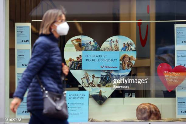 Pedestrian wearing a protective face mask passes a closed TUI AG travel center in Mainz, Germany, on Wednesday, March 10, 2021. Voters go to the...