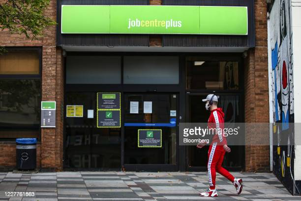 A pedestrian wearing a protective face mask passes a job center employment office in London UK on Friday July 24 2020 Almost half of businesses...