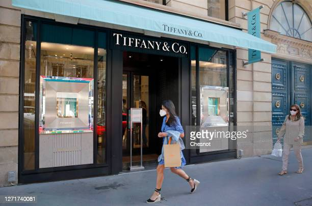 Pedestrian wearing a protective face mask walks past the US company's luxury jewelry store Tiffany & Co. On September 10, 2020 in Paris, France. The...