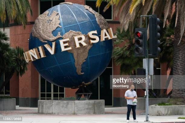 Pedestrian wearing a protective mask stands outside Universal Music Group headquarters in Santa Monica, California, U.S. On Friday. June 4, 2021. A...