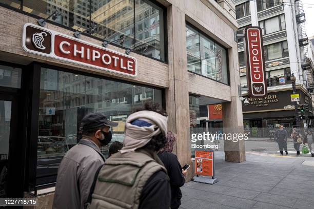 A pedestrian wearing a protective mask walks near a Chipotle Mexican Grill Inc restaurant in San Francisco California US on Monday July 20 2020...