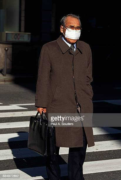 pedestrian wearing mask - overcoat stock pictures, royalty-free photos & images