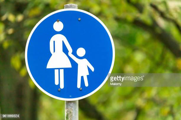 pedestrian zone sign in front of green trees. - pedestrian zone stock pictures, royalty-free photos & images