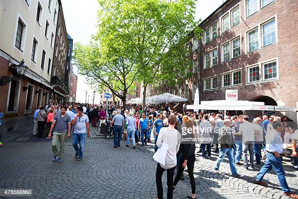 pedestrian zone with breweries and people in düsseldorf - feast of the ascension stock pictures, royalty-free photos & images