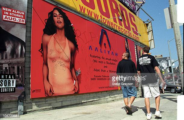 Pedestrians along Sunset Blvd look at billboard advertising the latest release of RB singer Aaliyah who died with 8 others died in a plane crash...