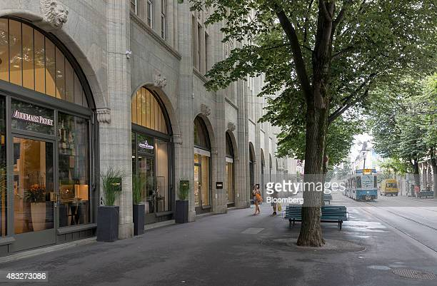 Pedestrians and a tram pass retail stores near Paradeplatz in Zurich Switzerland on Thursday Aug 6 2015 Swiss consumer sentiment declined in July to...