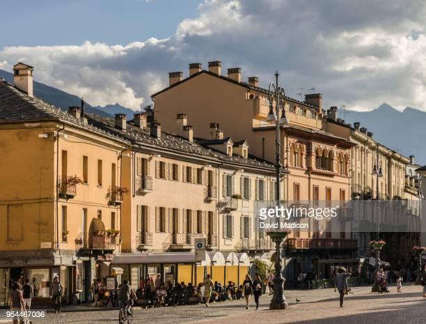 pedestrians and cafe in aosta, italy - valle d'aosta foto e immagini stock