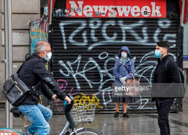 Pedestrians and cyclists wear protective face masks as they travel through Dublin City centre in Ireland on May 18 as Ireland cautiously begins to...