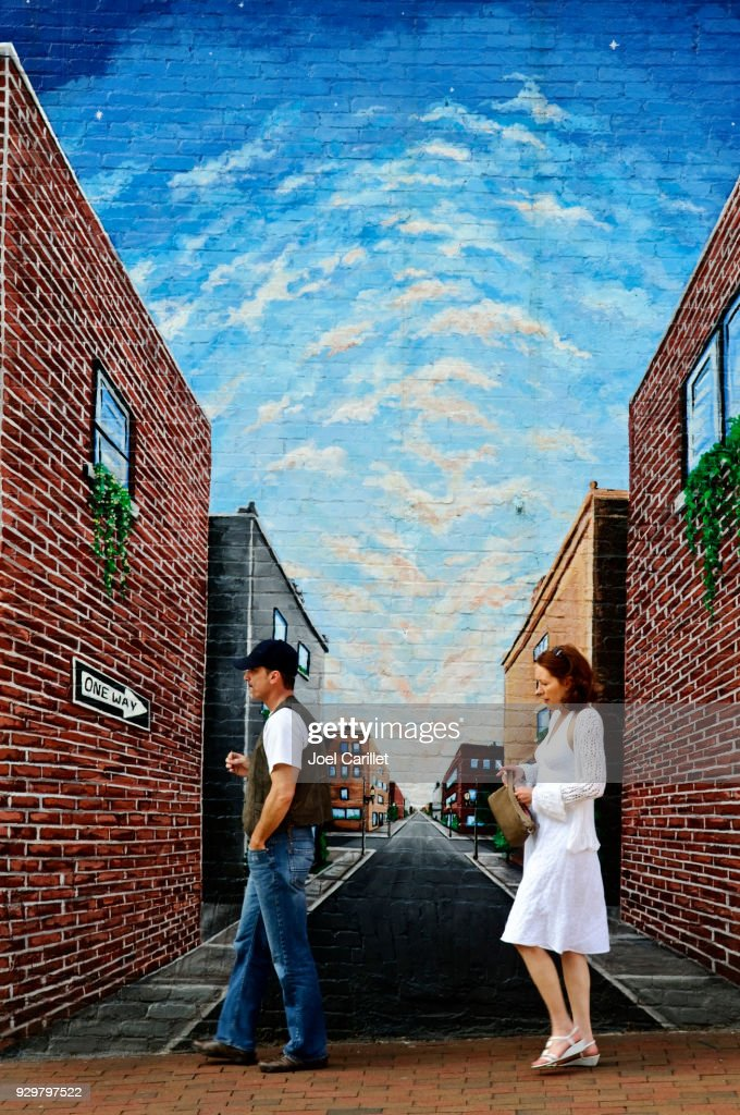 Pedestrians and downtown mural in Asheville, North Carolina : Stock Photo