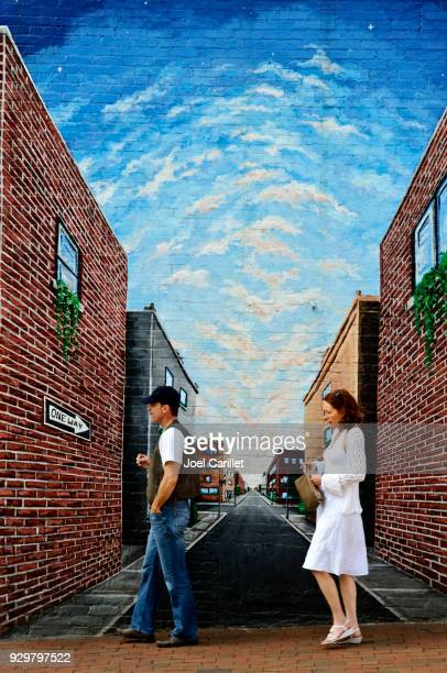 Pedestrians and downtown mural in Asheville, North Carolina