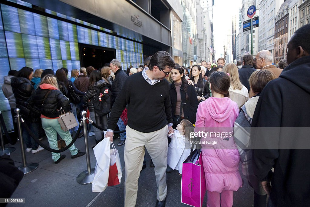 Pedestrians and shoppers fill the sidewalk on Fifth Avenue on 'Black Friday' on November 25, 2011, in New York City. Marking the start of the holiday shopping season, 'Black Friday' is one of American retailers' busiest days of the year.