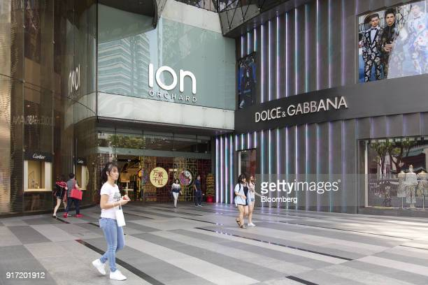 Pedestrians and shoppers walk past a Dolce Gabbana Srl boutique luxury store at the Ion Orchard mall jointly owned by CapitaLand Ltd and Sun Hung Kai...