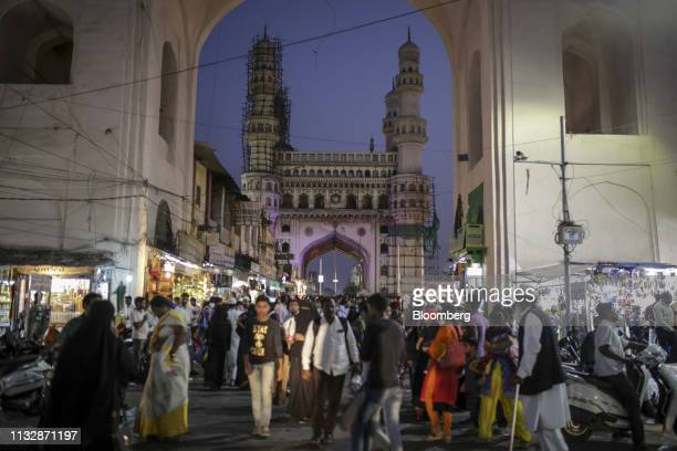 Pedestrians and shoppers walk past Charminar monument and mosque in Hyderabad, India, on Friday, March 15, 2019. The success of India's $5 billion...