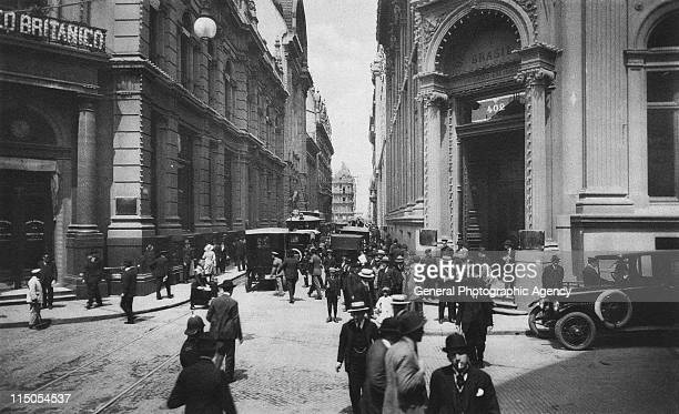 Pedestrians and traffic at the intersection of Bartolome Mitre and Calle Reconquista in downtown Buenos Aires Argentina circa 1905
