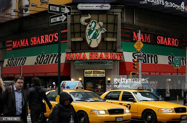 Pedestrians and traffic move past a Sbarro LLC restaurant in Times Square in New York US on Monday March 10 2014 Sbarro LLC the 800restaurant US...