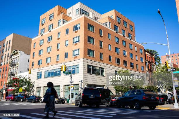 Pedestrians and traffic move past an Internal Revenue Service office building in the East Harlem neighborhood of New York US on Saturday June 24 2017...