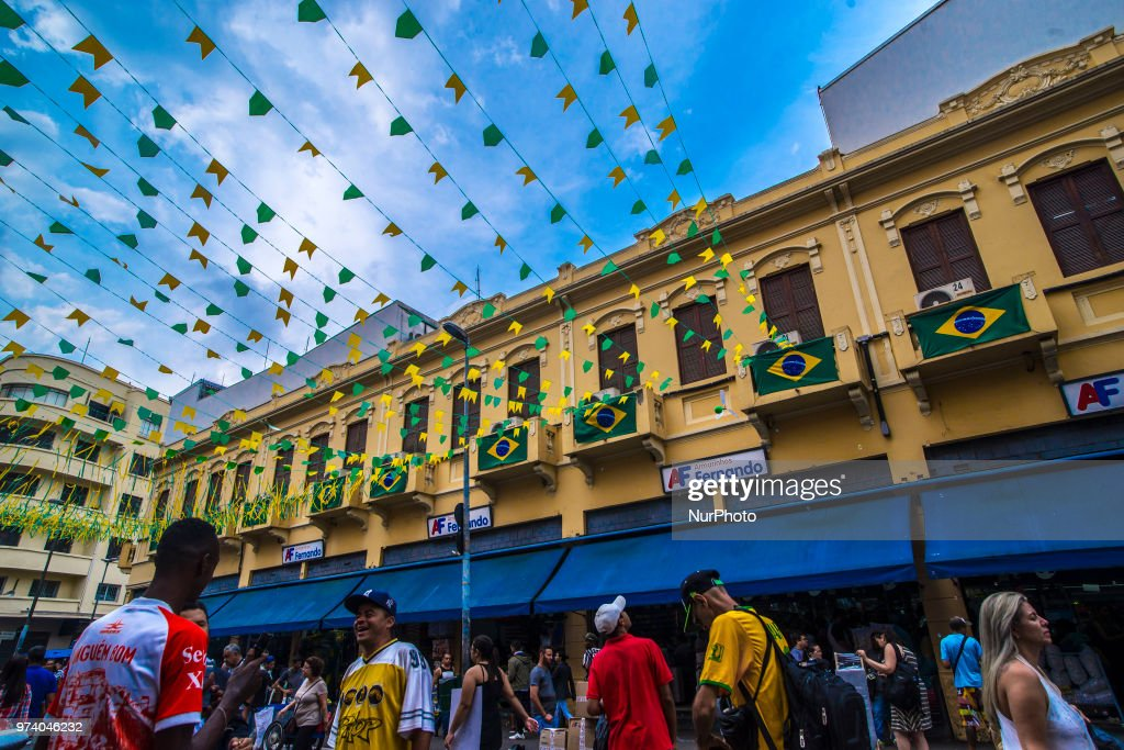 Pedestrians and traffic pass on a street decorated in Brazilian flags ahead of the FIFA World Cup games in downtown Sao Paulo, Brazil, onThrusday, June 14, 2018. In a curious quirk of Brazil's electoral calendar, for the last 28 years Latin America's largest economy has gone to the polls shortly after the World Cup. In the football-obsessed country, politicians have long attempted to hijack the sport to burnish their image.