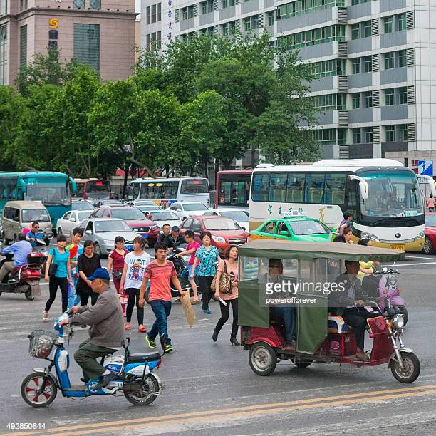 Pedestrians and vehicles on the streets of Xi'an, China