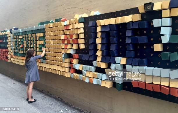 Pedestrians are invited to change the 'pixels' on this large wooden pegboard in an alley in downtown Chattanooga Tenn The city is home to dozens of...