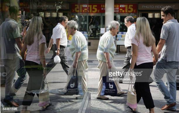 Pedestrians are mirrored in a shopping window on September 3 2005 in Wiesbaden Germany Germany's economy and pension system is being burdened by an...