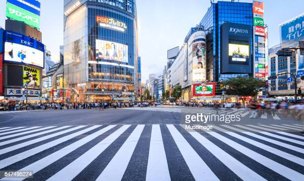 Pedestrians are preparing to cross the Shibuya crossing