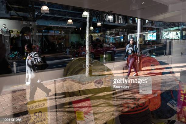 Pedestrians are reflected on a window of a store in the central business district of Wellington New Zealand on Wednesday July 18 2018 New...
