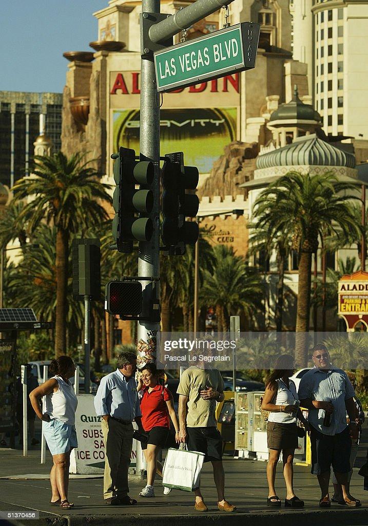 Pedestrians are seen on Las Vegas Boulevard, September 17 in Las Vegas.