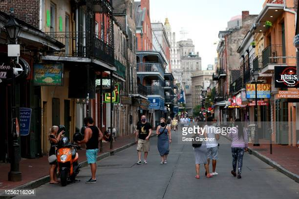 Pedestrians are seen walking along Bourbon Street in the French Quarter on July 14, 2020 in New Orleans, Louisiana. Louisiana Gov. John Bel Edwards...