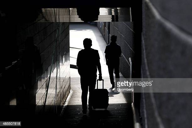 Pedestrians are silhouetted walking through a tunnel near the Cheonggyecehon stream in Seoul South Korea on Friday Aug 28 2015 South Korea is...