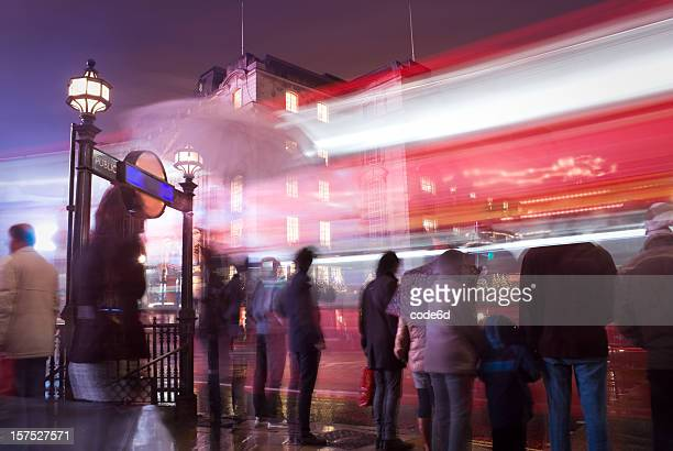Pedestrians at Piccadilly Circus, London, on a rainy night
