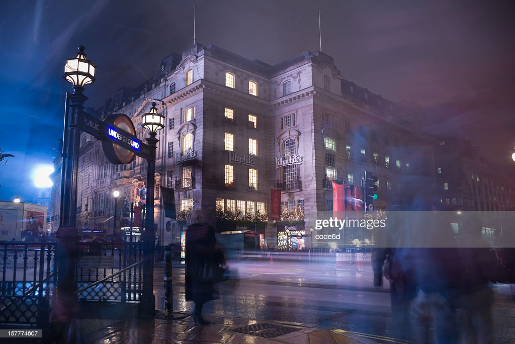 Pedestrians At Piccadilly Circus London On A Rainy Night Stock Photo