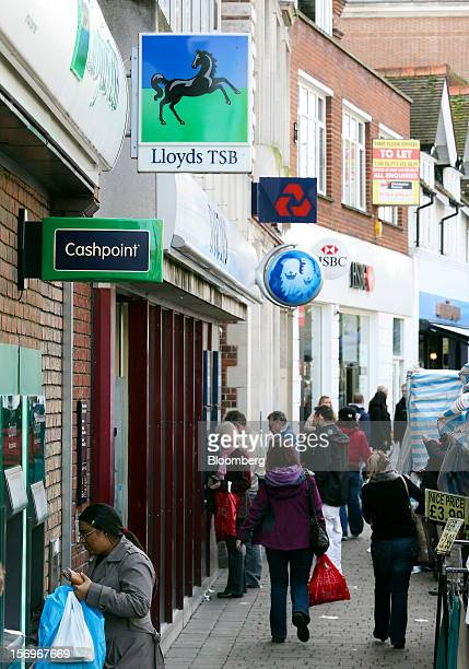 Pedestrians bass branches of a Lloyds TSB bank part of the Lloyds Banking Group Plc a Barclays Bank Plc bank a NatWest bank part of the Royal Bank of...