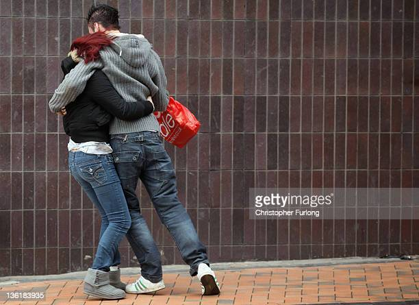 Pedestrians battle against gale force winds in Adelaide Street West next to the promenade in Blackpool on December 28 2011 in Blackpool England Most...