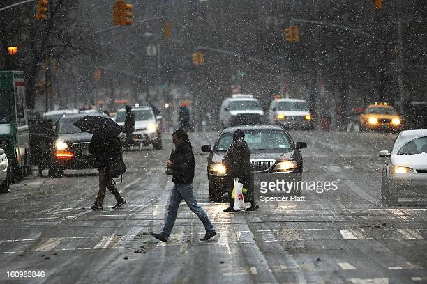 Pedestrians battle wind snow and sleet as Manhattan prepares for a major winter storm on February 8 2013 in New York City New York City and much of...